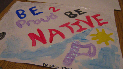 Be Proud 2 Be Native, says a youth's painting.